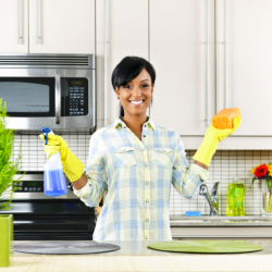 girl cleaning the kitchen